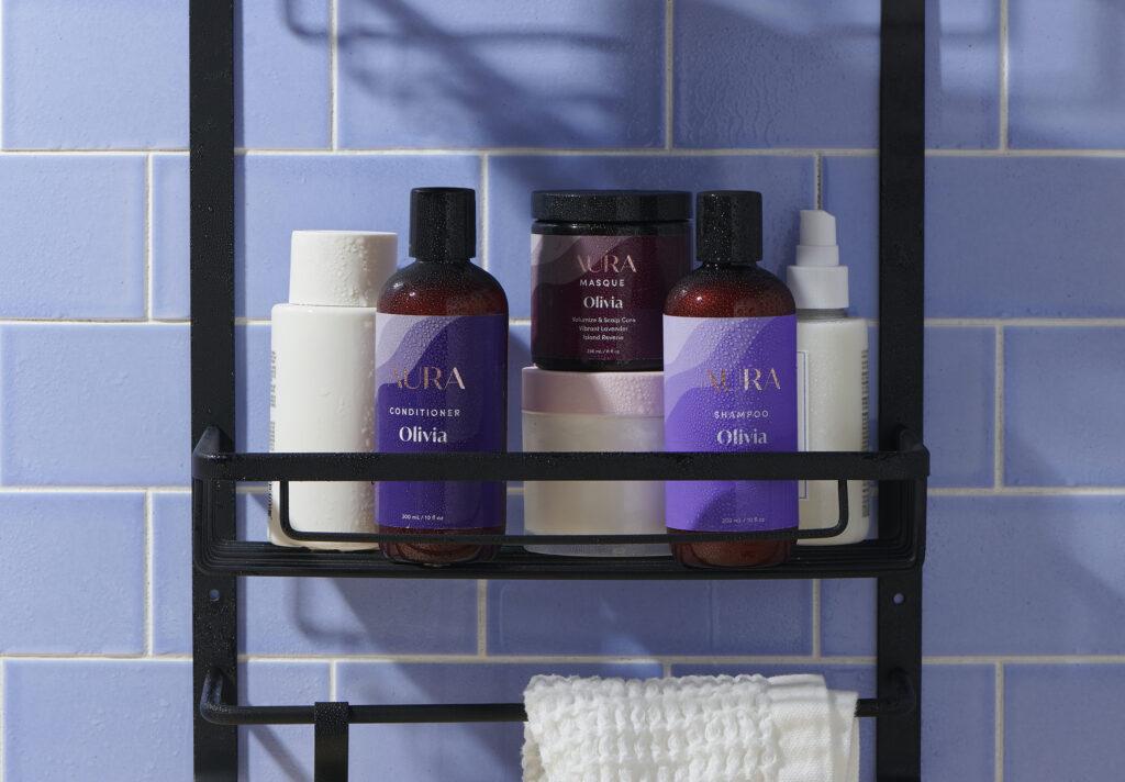 AURA custom hair care in a shower caddy