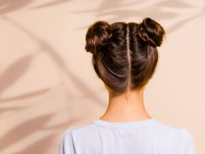 Girl showing us the back of her space bun hairstyle