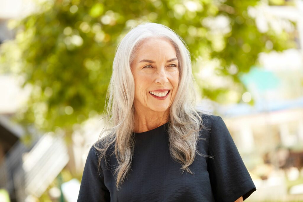 AURA client with fully gray hair color thinking about adding temporary Fantasy or Classic pigments to her personalized hair care products.