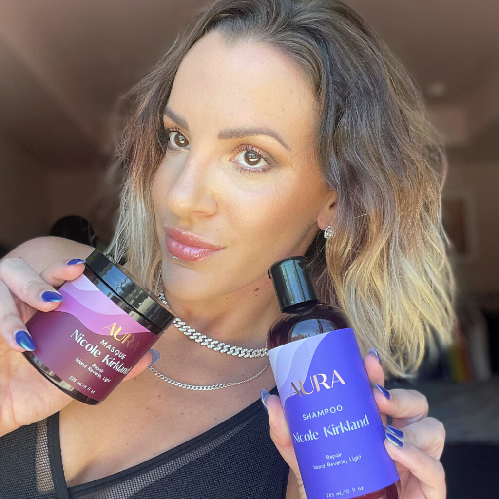 Nicole showing off her AURA personalized hair care Ritual with a smile